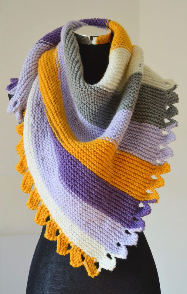 Free Knitting Pattern for Dragon Tail Shawl - Garter stitch shawl with easy decorative edge. Perfect showcase for multi-color or self-striping yarn. Aran weight yarn. Designed by Wiam's Crafts. Uses just 2 ball of the recommended yarn.