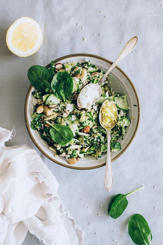 Green detox quinoa salad with spring herbs, broccoli, avocado, ginger and matcha