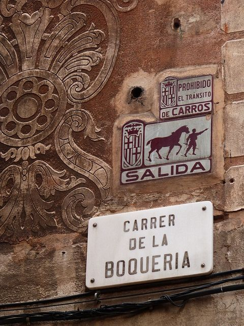 This is a street sign in Barcelona. They are on the corners of buildings...usually lol