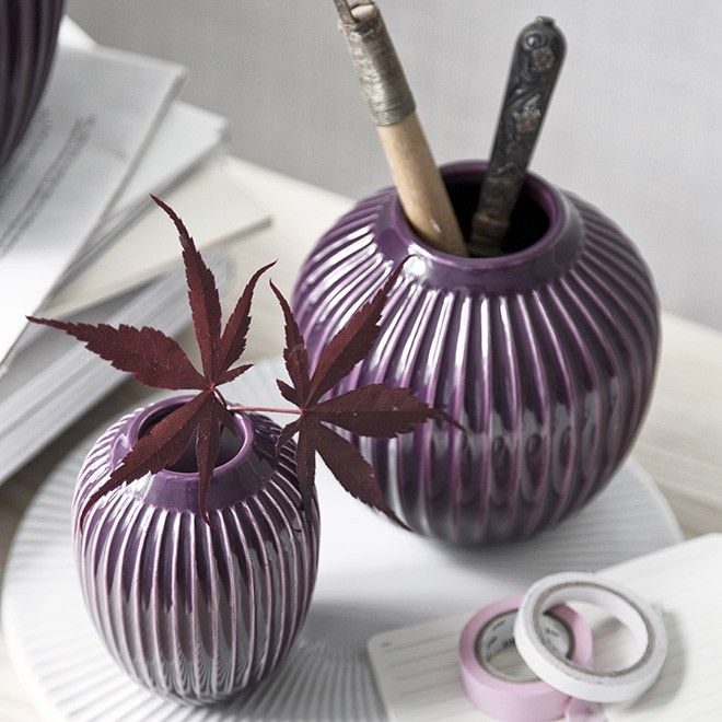 The beautiful plum Kähler vase in the Hammershøi range is inspired by Svend Hammershøi's voluminous vases, which he created at Kähler's old workshop in the 20th century. In the Hammershøi range, Hans-Christian Bauer has reinterpreted the old works and created a range with the same distinctive furrows.