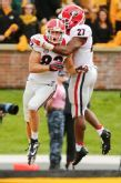 COLUMBIA, MO - OCTOBER 11:  Michael Bennett #82 celebrates with Nick Chubb #27 of the Georgia Bulldogs after Michael Bennett scored the second touchdown of the game against the Missouri Tigers in the second quarter on October 11, 2014 at Faurot Field/Memorial Stadium in Columbia, Missouri. (Photo by Kyle Rivas/Getty Images)