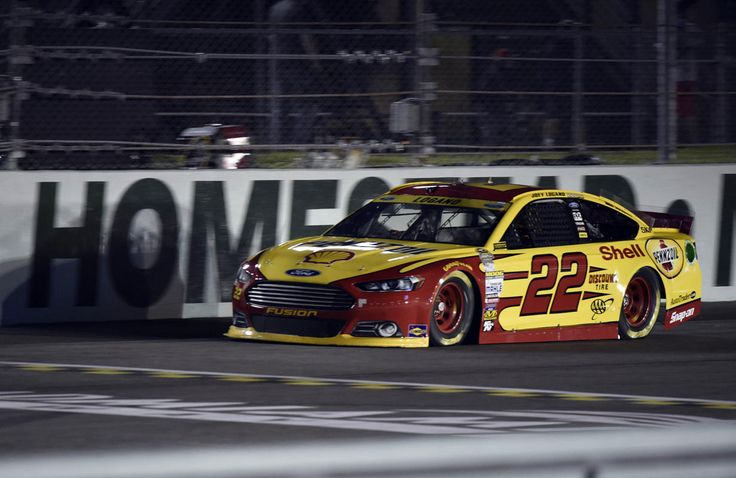 NASCAR: Ford EcoBoost 400-Qualifying Nov 14, 2014; Homestead, Miami, USA; NASCAR Sprint Cup Series driver Joey Logano during qualifying for the Ford EcoBoost 400 at Homestead-Miami Speedway. (Jerome Miron-USA TODAY Sports)