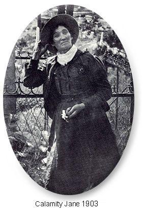 Calamity Jane standing in front of Wild Bill Hickok's grave, Deadwood, SD, 1903.