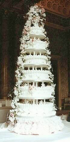 This lavish wedding cake designed by David for HRH Prince Andrew and Miss Sarah Ferguson was six tiers and stood over 7 feet tall. The cake was adorned with trailing fresh flower cascades in white and soft pink. The design was inspired by the society wedding and fashion styles of the late nineteenth century. Buckingham Palace asked David to display his creation in the Palace's Blue Room.