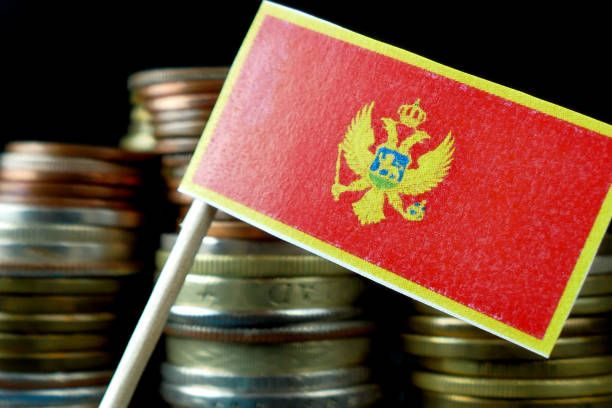 montenegro flag waving with stack of money coins macro