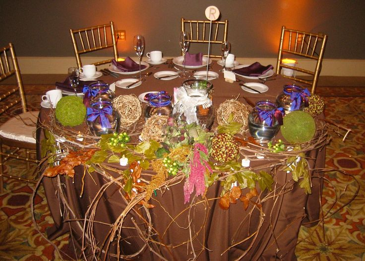 Rustic and colorful enchanted decor on the sweetheart table awaiting the bridal party flowers. Clair Pruett Photography.