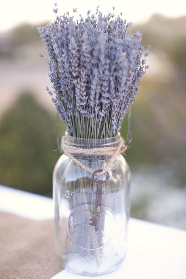 Dried lavender in a mason jar. Mason jars and vintage glass make wonderful containers for flowers (and I love the way the old key on a string adds charm). Think outside the vase!