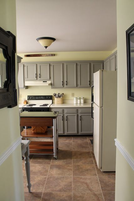 Wall color soft sunlight by valspar cabinet color french for Grey yellow kitchen ideas