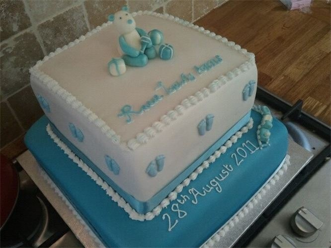 Christening cake : A customer order for a christening cake.. A chocolate top tier, and vanilla bottom tier.  With hand crafted topper bear and piping detail...