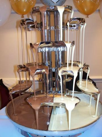 double chocolate fountain. just for @Sarah Chintomby Hibbard