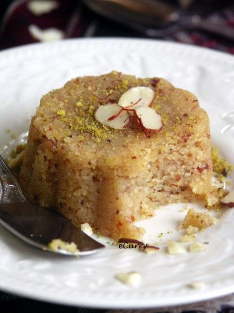 Semolina and Almond Halwa. Definitely best served fresh and in large amounts. I tried molding it into little cookie sizes and letting it cool and it just wasn't the same.