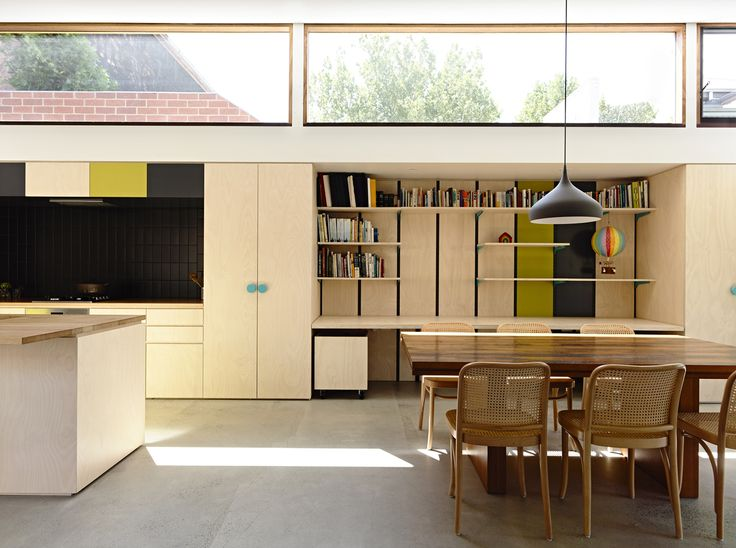 Another good example of kitchen with complementary desk and sheving and nice big highlight windows by Rob Kennon Architects | Datum House