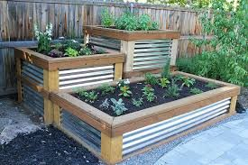 Tiered planter boxes with corrugated metal sides: Gardens Ideas, Gardens Beds, Metals Roof, Corrugated Metals, Tiered Planters, Herbs Garden, Gardens Yard, Planters Boxes, Metals Side