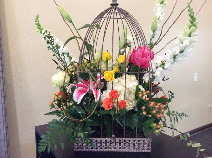 Whimsical Arrangement in Birdcage