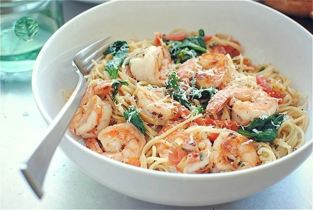 Shrimp with lemon, spinach, tomatoes, and angel hair pasta.