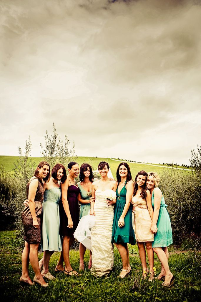 mixed and matched bridesmaids dresses in teal