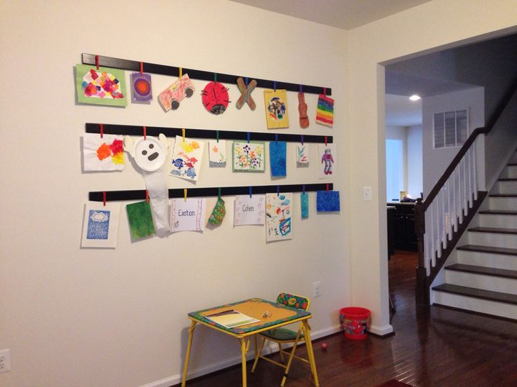 Our new DIY art display!  Three pieces of plain trim, glue, and black spray paint from Lowe's; 24 clothespins, craft paint, and Command picture hangers from Wal-mart!  Lots of patience needed to disassemble and reassemble clothespins.
