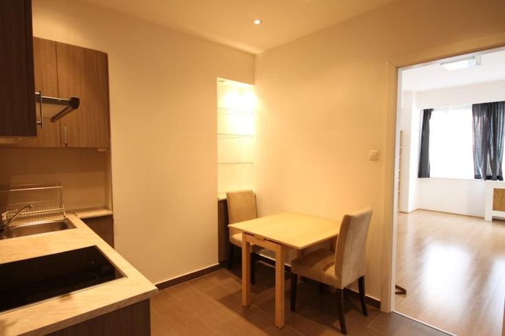 Well-equipped kitchen with dining table and the spacious room