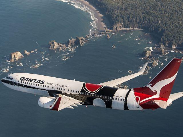 "Qantas Flying Art series Boeing 737-800 christened ""Mendoowoorrji."" Livery based on Aboriginal artist Paddy Bedford's 2005 painting ""Medicine Pocket."""