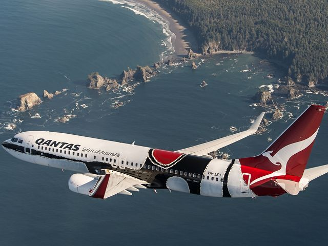 "Qantas Flying Art series Boeing 737-800 christened ""Mendoowoorrji."" Livery based on Aboriginal artist Paddy Bedford's 2005 painting ""Medicine Pocket."""