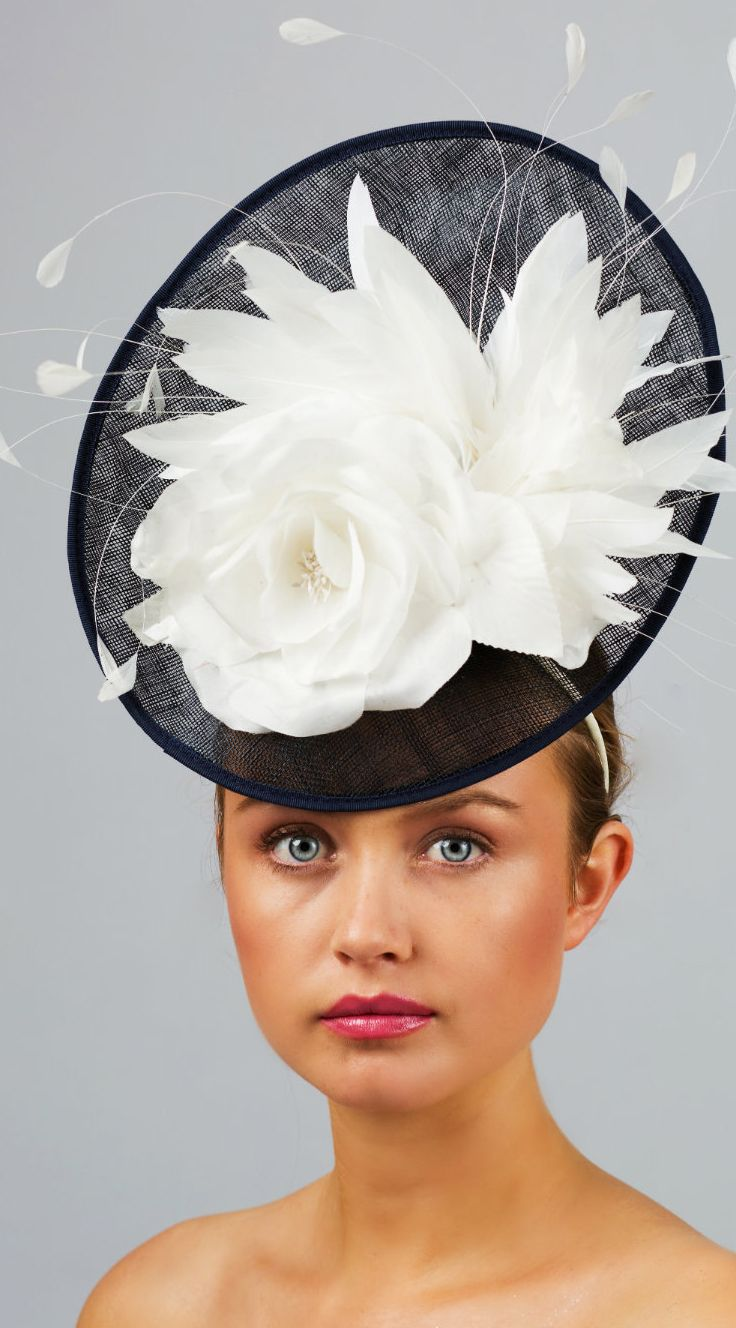 Victoria Fascinator Headpiece. Navy Blue & Ivory Feather Fascinator/Headpiece Shell Base mounted onto a headband, finished with silk flowers and a variety of leaf shaped feathers. Kentucky Derby, Dubai World Cup Races, Royal Ascot, Epsom Derby, headpiece fascinator. Fashions on the Field. #millinery #handmade #fascinators #hats #kentuckyderby #fashion #fashionista #affiliatelink #fashionsonthefield #racingfashion