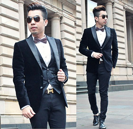Tight men's formal outfit with waistcoat and belt