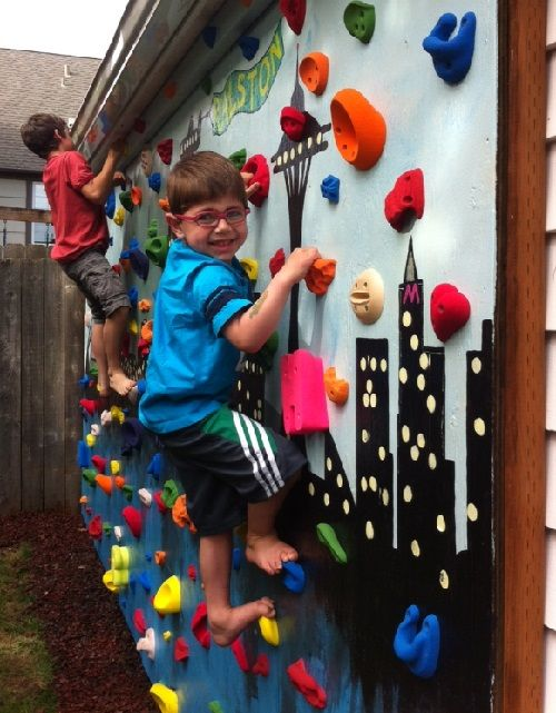 DIY Backyard Climbing Wall ~ with tutorial Wish I had a fence so I could do this for the boys.