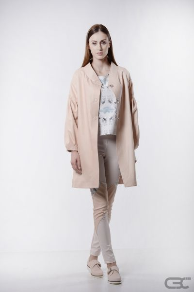 http://cbcdesign.ro/en/shop/pardesiu-rose-mousse/  Midi overcoat with oversized sleeves and faux-kimono collar from misty rose eco leather. The overcoat has a false-detachable back, meaning that a digitally printed cloak is attached to the back of the product, which can be concealed in a hidden pocket in order to offer a different overall look. Product also available in black.