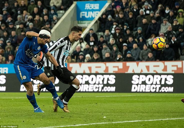 Ayoze Perez puts the ball into his own net as he tries in vain to keep Shinji Okazaki from scoring for Leiecester