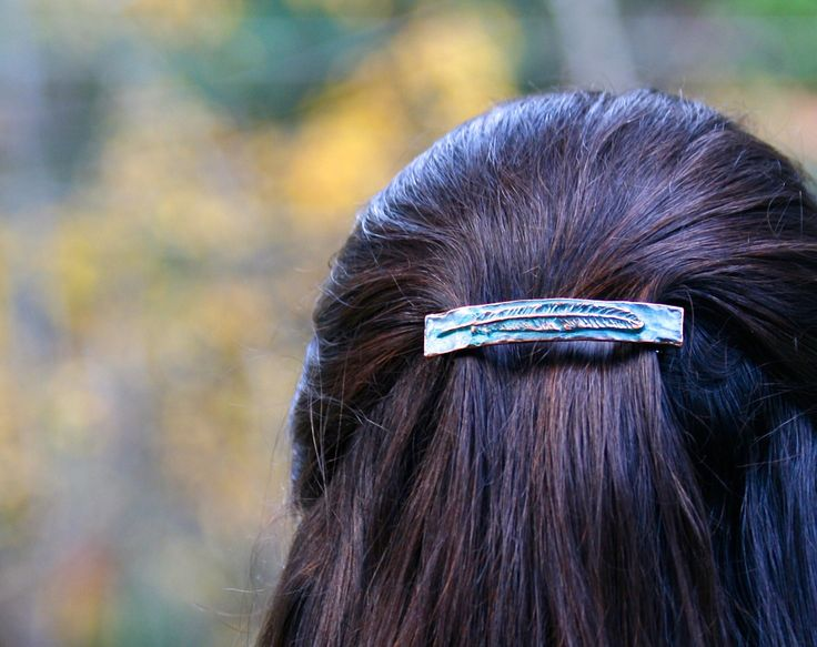 Feather Barrette. This unique piece is handcrafted using lost wax casting. Made of silver pewter and copper with a blue green patina.