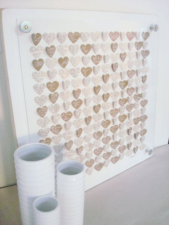 Wedding Hearts Guest Book--I'm thinking DIY and doing Kraft or White Paper, Black and White Pictures, Green or Red Heart for Nick & Me... P.S. Includes what to have at the table for guests so they get the picture