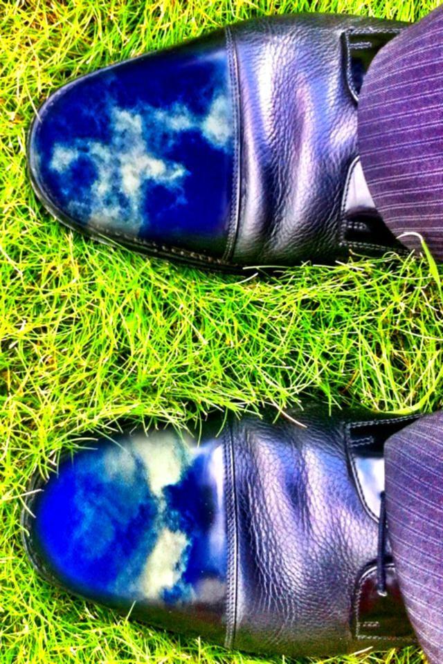 Polished shoes reflecting the morning sky