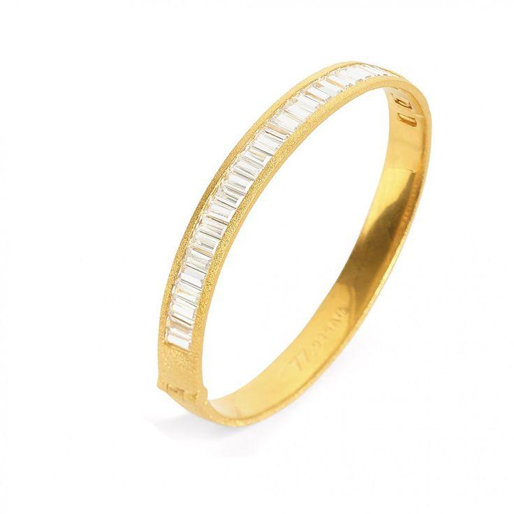 BERND WOLF - Armreif Babette aus der Designlinie Solenne in Silber mit einer 24 - Karat Goldplattierung in Premiumqualität mit funkelndem Zirkonia in Baguetteschliff. Jetzt entdecken unter www.berndwolf.de