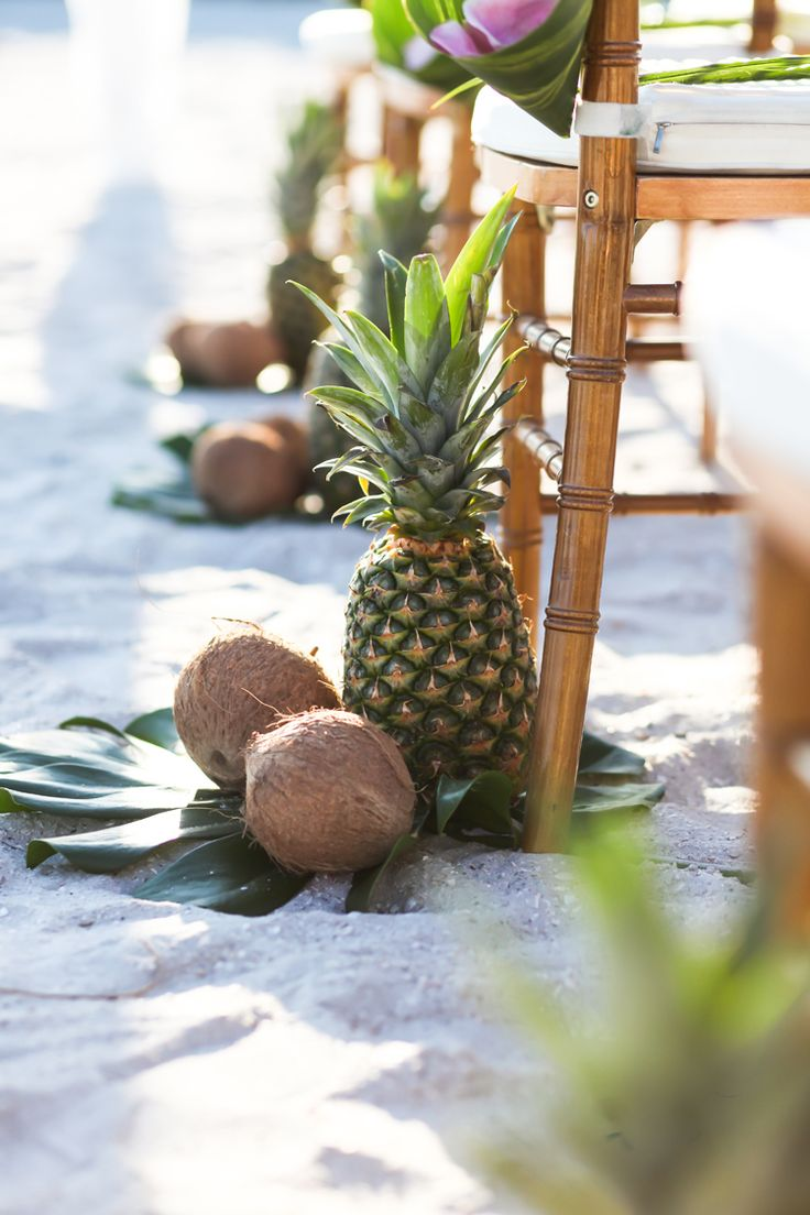 Tropical beach wedding ceremony ideas and inspiration: Pineapple, coconut and palm leaf aisle markers (Lifelong Photography Studio)