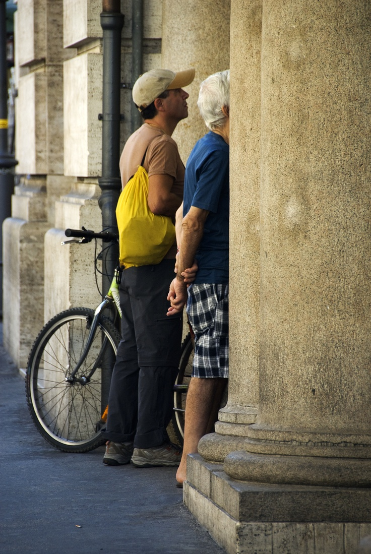 Two Italians in Rome, reading the paper that has been put up on a public wall. I have seen this in China as well, where they put the paper up on public boards. The relaxed air of the men reminds me a little bit of India.