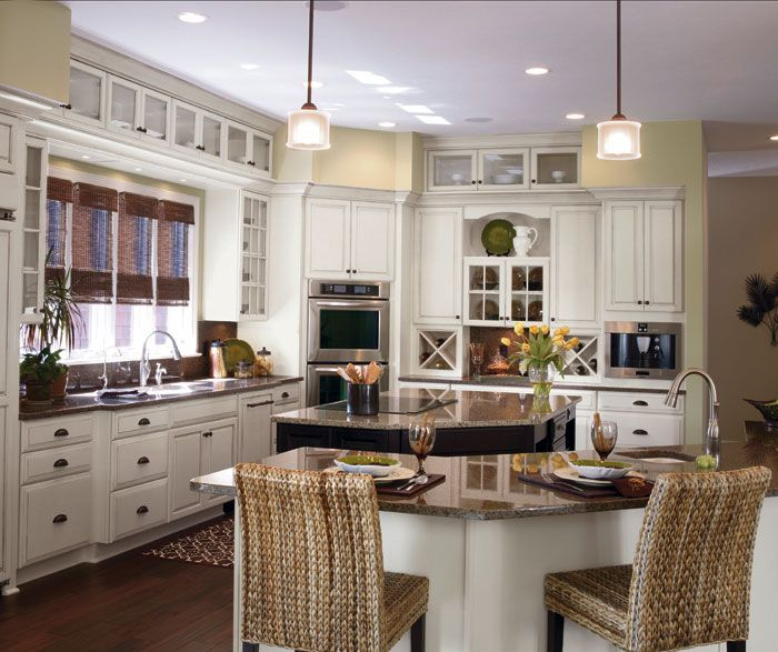 Off white cabinets with a dark Cherry kitchen island by Kemper Cabinetry