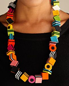 "An artful accent to any attire. This playful necklace showcases hand cut and sewn wool felted cubes of ""licorice candy""."