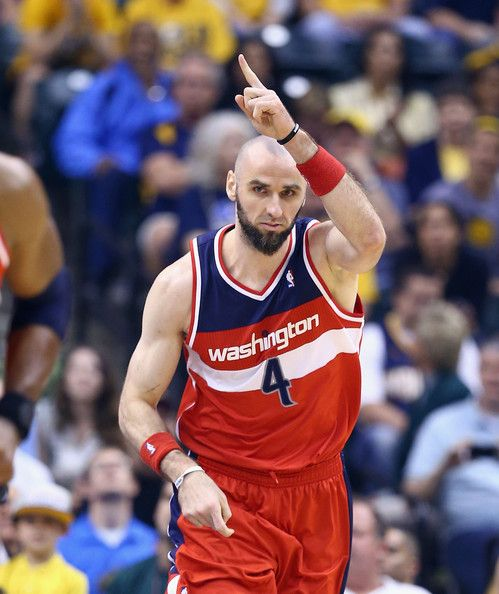 Marcin Gortat #4 of the Washington Wizards celebrates against the   Indiana Pacers in Game 5 of the Eastern Conference Semifinals during the...
