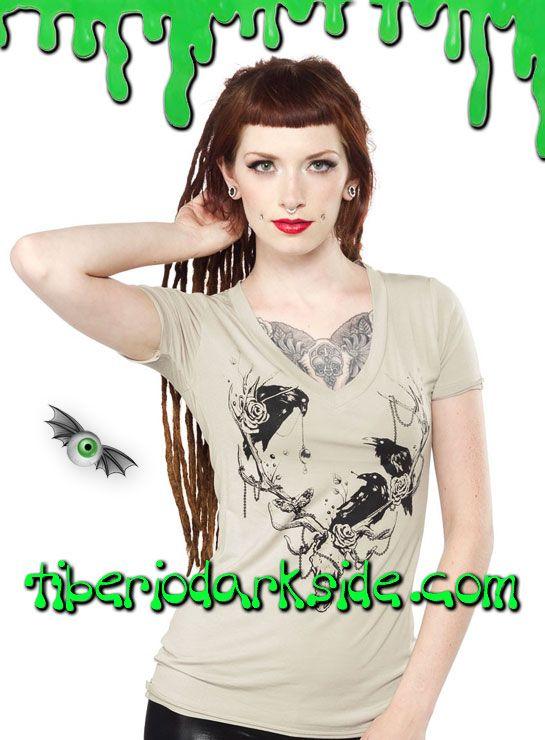 TIBERIO DARK SIDE DISTRIBUIDOR OFICIAL DE SOURPUSS EN ESPAÑA  THE ANTLERS T SHIRT  Camiseta beige de manga corta con cuello de pico y motivo frontal de cráneo de ciervo y cuervos. Materiales: 95% modal, 5% spandex. Marca: Sourpuss.  COLOR: BEIGE TALLAS: S, M, L, XL, XXL  S - 82 cm pecho (EU talla 36, MEX talla 26, UK talla 8) M - 88 cm pecho (EU talla 38, MEX talla 28, UK talla 10) L - 94 cm pecho (EU talla 40, MEX talla 30, UK talla 12) XL - 100 cm pecho (EU talla 42, MEX talla 32, UK…