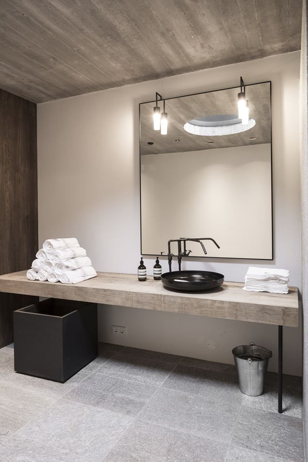Gaaaah! So perfect! white walls, reclaimed wood counter, mirror and lights with ceiling texture (Id put a storage shelf instead of the planter box)