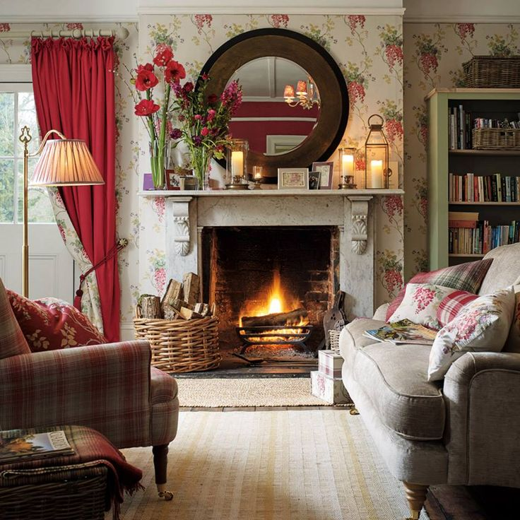 This is such a cheerful Family Room with lovely flowered wallpaper and pops od red color.