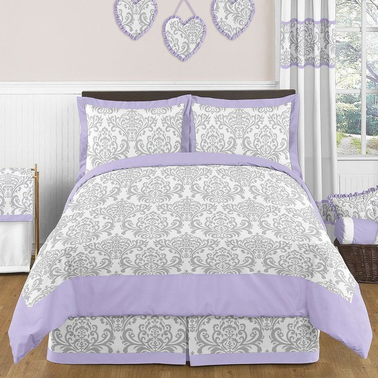 The Sweet Jojo Designs 3-piece Elizabeth bedding collection will create a stunning boutique setting for your child. Boasting a damask print, this set features a gorgeous gray, lavender, and white finish