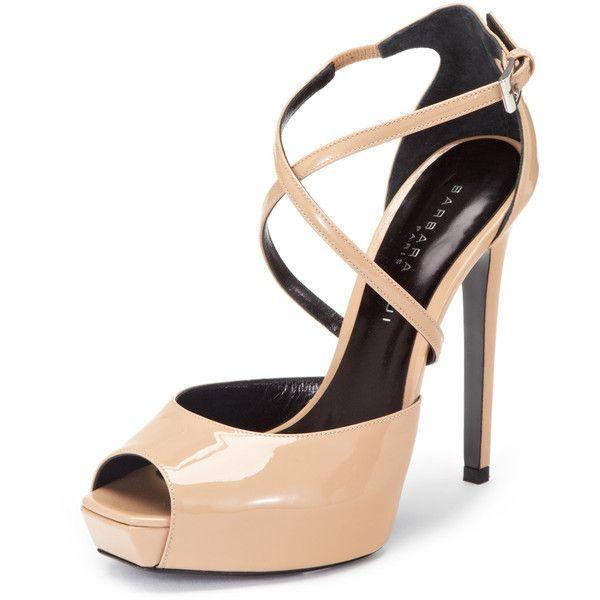 High heel platform peep-toe sandal * Patent leather upper * Adjustable buckle at ankle strap * Covered heel and platform * Leather insole and sole Measurements…