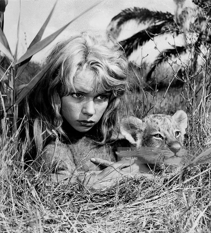 0 Marion Michael with lion cub