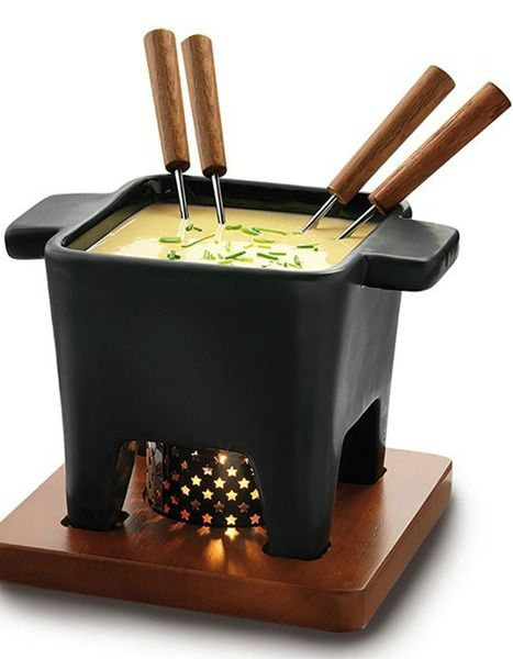 Turn up the heat on your favorite cheese with this stylish, black fondue set. Complete with ceramic pot, solid dark wooden board, 4 forks and 1 tea light, the Boska Tapas Fondue Set is your go-to quick party solution. As is key to any successful cheese-warming celebration, the Boska set is engineered to maintain a constant, ideal temperature.