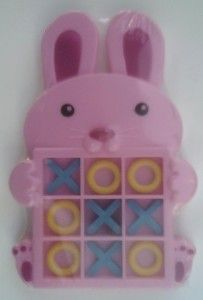 Pink Bunny Tic Tac Toe Game Plastic tic tac toe game with 5 Xs and 5 Os. http://awsomegadgetsandtoysforgirlsandboys.com/creative-easter-basket-ideas/ Pink Bunny Tic Tac Toe Game