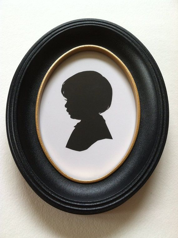 5X7 inch black oval frame with hand painted gold trim. Frame is plastic with glass and a cardboard backing, ready to hang.    This is the exact Silhouette frame they sell at Walt Disney World and Disneyland. This listing is for the frame only, silhouette sold separately.