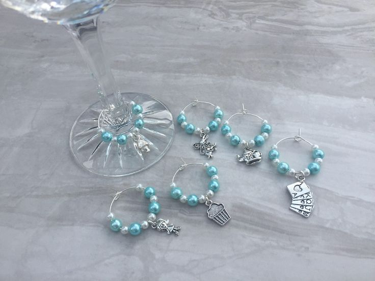 A personal favourite from my Etsy shop https://www.etsy.com/uk/listing/528146327/alice-in-wonderland-wine-glass-charms
