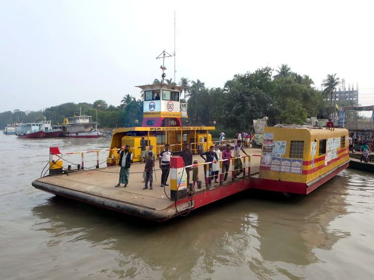 A ferry carries cars and pedestrians across the Rupsa Riiver at Khulna, Bangladesh. Since the opening of a bridge just downstream in 2005 far fewer vehicles use the ferry.
