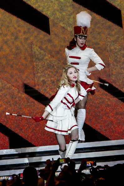 Madonna Photo - Madonna keeps her clothes on but still manages to send fans into a delirium at the the Olympic Stadium in Rome during her MDNA tour